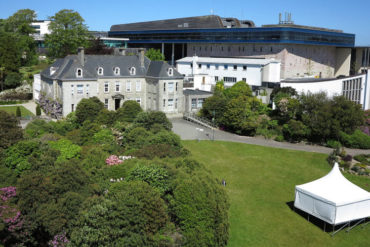 View of Tremough House looking over the grounds, with the Exchange Building in the background